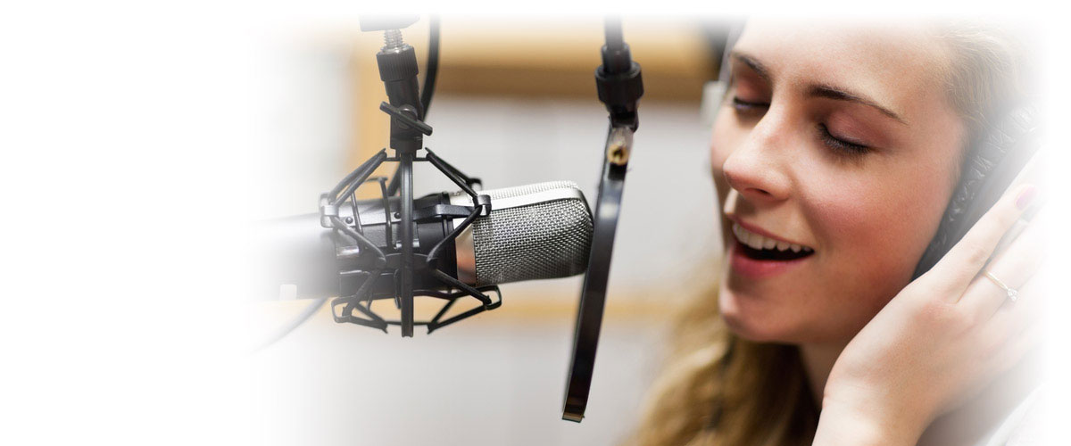 Woman singing in studio